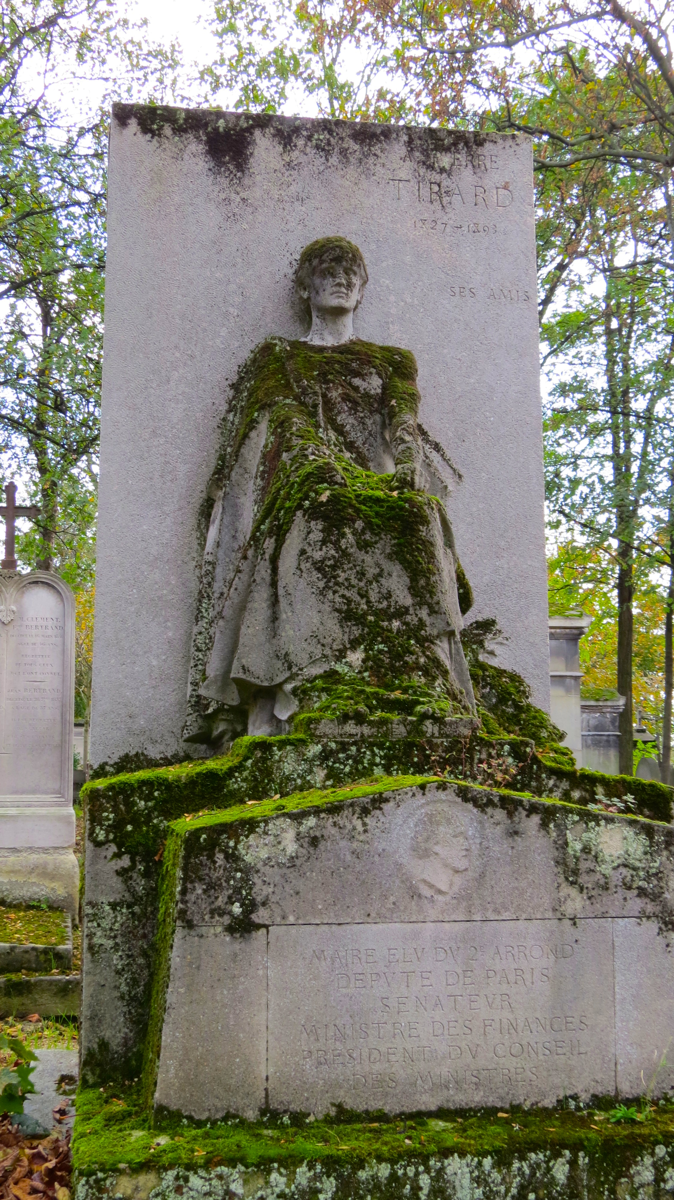 moss-covered grave statue